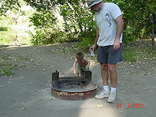 Dave and Hunter chase a lizzard around the firepit.